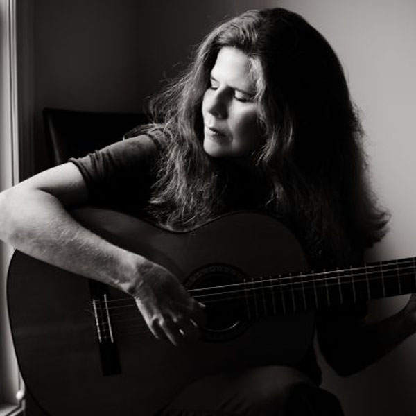 Michelle Qureshi Playing guitar